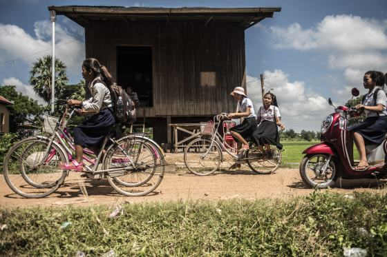 School girls biking in Cambodia