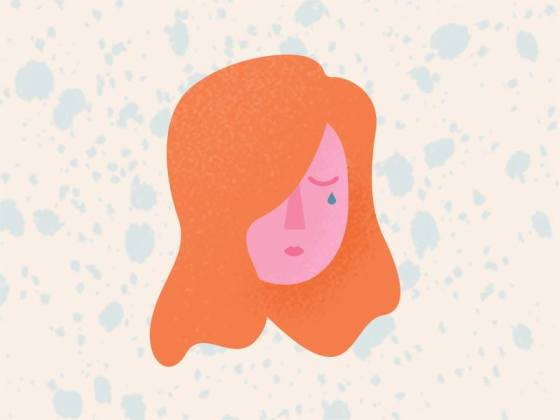 A drawing of a sad woman crying with red hair