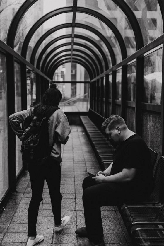 A girl and a boy waiting for the train